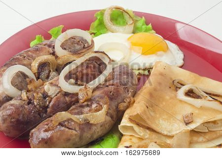 Pancakes With Sausage And Onions On A White Background