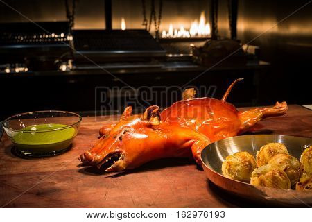Whole Brown Barbecued Suckling Pig On The Table