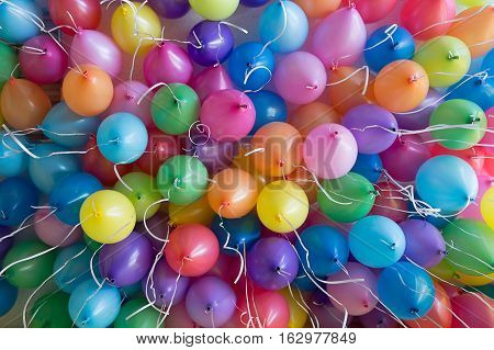festive, colorful balloons with helium. attachment to the white ribbons