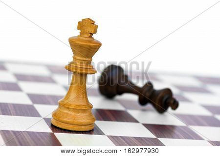 white chess king check black on chessboard