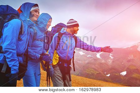 hikers on the trail in the Islandic mountains. Trek in National Park Landmannalaugar, Iceland