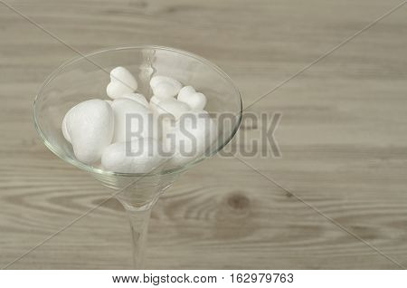 Valentines day - A martini glass filled with different size polystyrene hearts