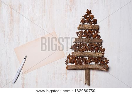 Christmas tree decoration with copy space on white wooden background