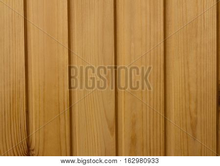 background texture of spruce wood board wall brown vertical