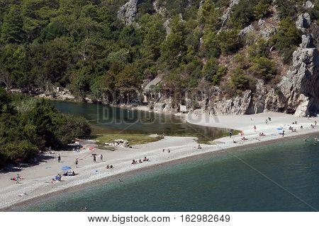 People on Olympos Beach in Kemer, Antalya, Turkey