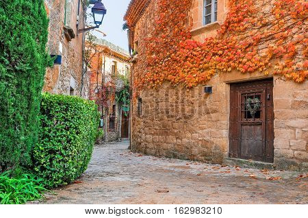 A street in the old town of Peratallada, Catalonia, Spain. Medieval street in the mediaval town in Europe. Panoramic view of old town in beautiful evening light at sunset.