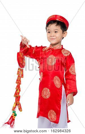 Portrait of a funny and exciting Vietnamese boy with firecrackers. Asian Kid Celebrating New Year