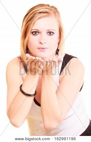Gesture flirt coquet concept. Beautiful blonde woman sending air kiss. Studio shot isolated.