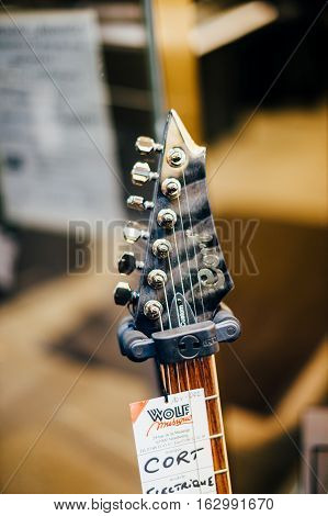 STRASBOURG FRANCE - DEC 20 2016: CORT guitar head with price tag