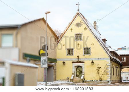 Architectural diversity in centre of resort Estonian town Parnu. Yellow stoned old building Seegi Maja. Snow-covered streets of tourist Baltic city in winter. Parnu Estonia