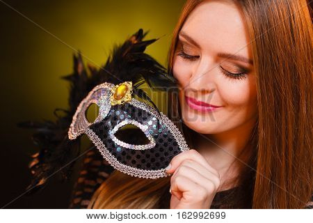 Sensual Lady Holding Carnival Mask.