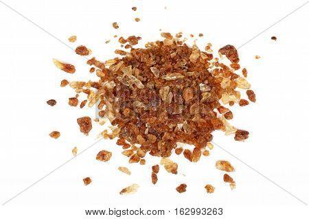 Pinch Of Brown Caramel Sugar Spilled On White