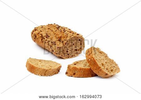 Sliced wholemeal baguette isolated on white background