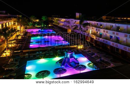 swimming pool with lighting in modern European hotel at night