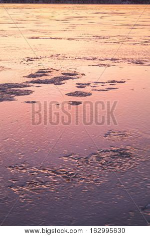 sunset with tracks in snow winter background