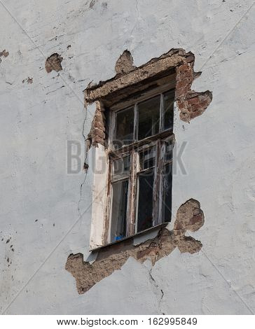 An old window with partly destroyed frame.