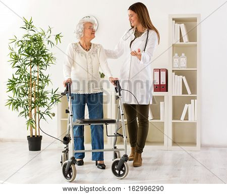 Senior woman with walker on consultation with the doctor in ambulance