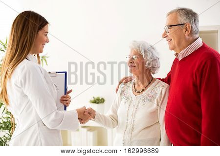 Smiling And Happy Senior Couple Visiting A Doctor