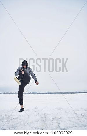 Athlete warming up in the winter on the nature