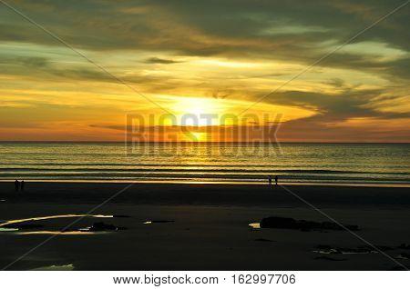 sunrise at cloudy lowtide, wells beach, maine