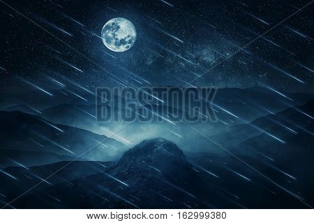 Full moon night landscape as blue stars falling above the misty hills in the center of nature. Beautiful wildlife scene screensaver.