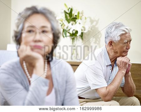 senior asian couple having relationship problem angry with each other.