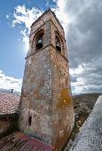 Bell tower of San Millan de Lara Church Burgos Province Spain. It was building on 1165 in Romanesque style poster