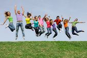 Happy smiling diverse group of jumping teenager people poster