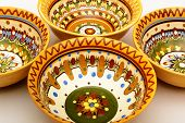 Traditional colored pottery. Painted ceramic multicolored plate. poster