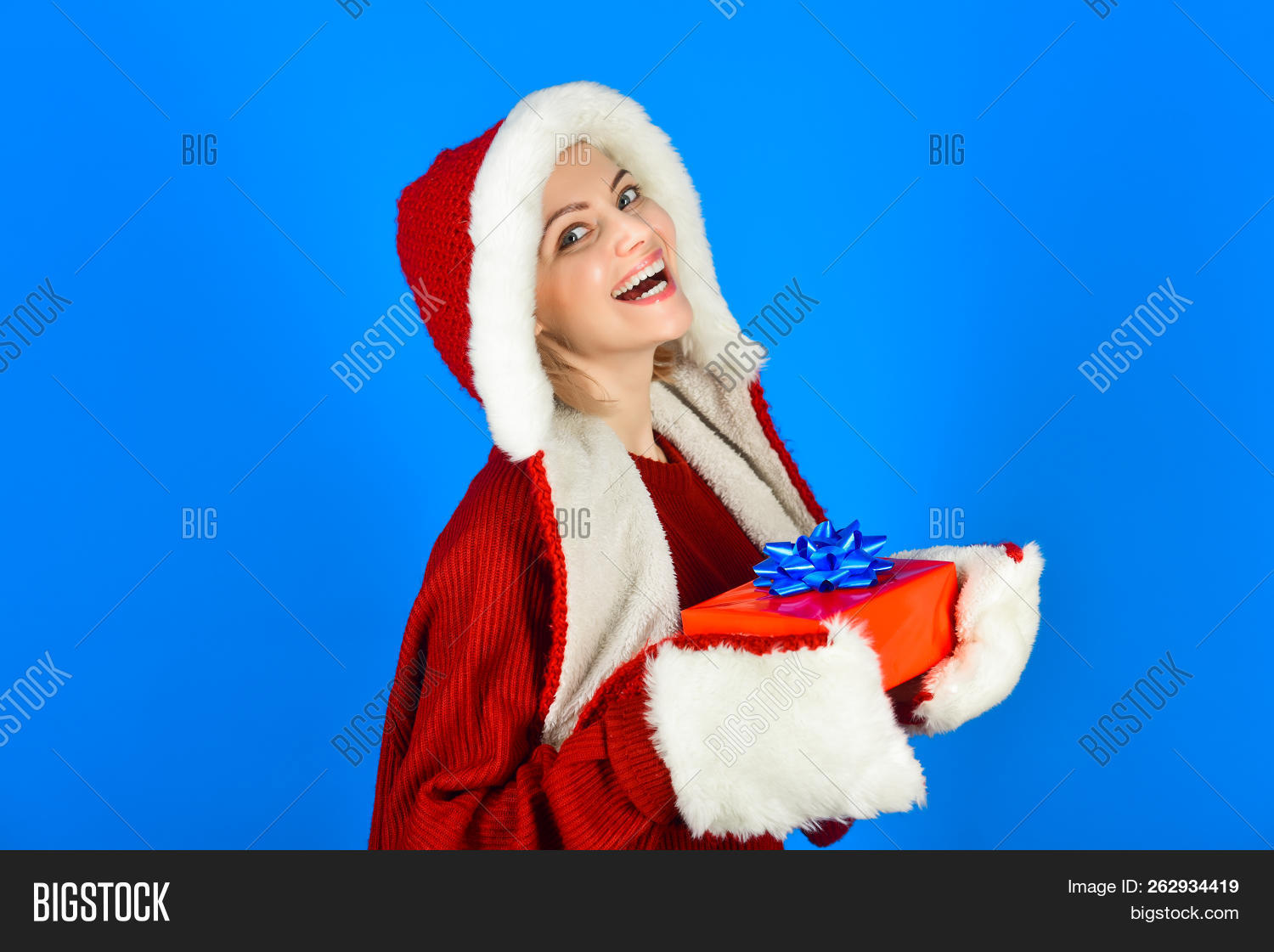 31d2e6e872f9c Happy Woman In Santa Hat Holds Christmas Present. Excited Woman In Santa  Claus Hat With