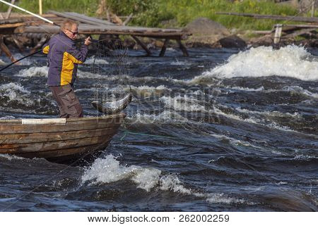 Kukkolaforsen, Sweden On June 27. View Of The Rapids In The River And An Unidentified Fisherman In A