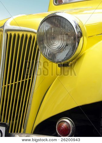 Closeup of front yellow retro car