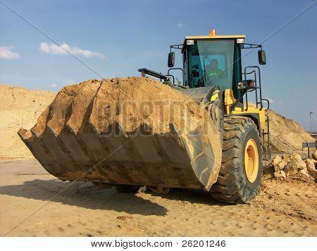 Backhoe loader with loaded soil