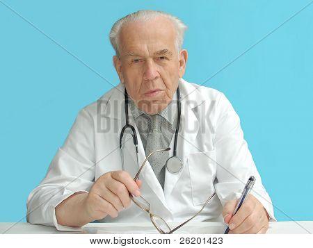Senior family doctor with stethoscope