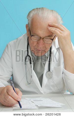 Senior family doctor prescribing medication