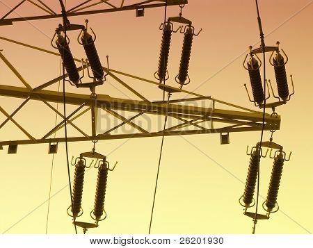High voltage pylon with insulators over sunset sky poster