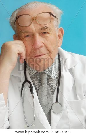 Portrait of senior family doctor with stethoscope