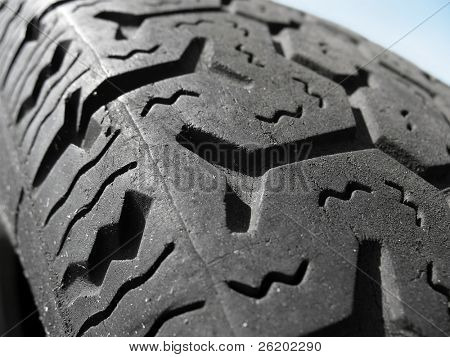 Extreme closeup of used car tire tread