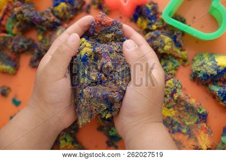Child Hands Playing Multicolored Kinetic Sand. Children Activity Game Toy For Model Forming Craft An