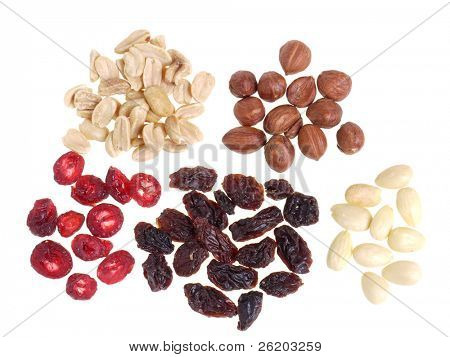 Dried sliced cranberry, raisins, hazelnuts, groundnuts and almonds over white background