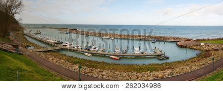Small Yacht Port With Pier. Sailboat Harbor, Many Moored Sail Yachts In The Sea.