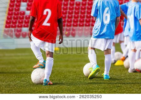 Boys Soccer Team Training. Soccer Football Players Training. Kids Playing Soccer On A Stadium Field.