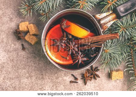 Mulled Wine  Ingredients In A Small Vintage Pan On The Gray Slate Background. Christmas Or Winter Wa