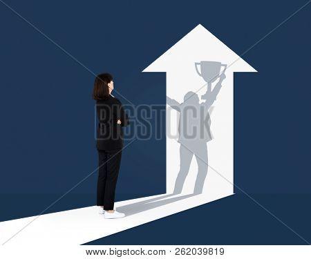 Businesswoman imagining her future success