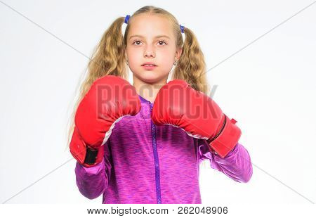 She ready to defend herself. Sport upbringing for girls. Feminist movement. Self defence concept. Girl boxer knows how defend herself. Girl child strong with boxing gloves posing on white background poster