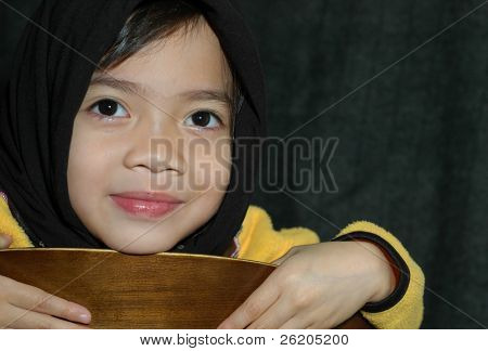 Little Muslim girl in black veil