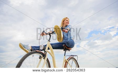 Woman Feels Free While Enjoy Cycling. Girl Rides Bicycle Sky Background. Most Satisfying Form Of Sel