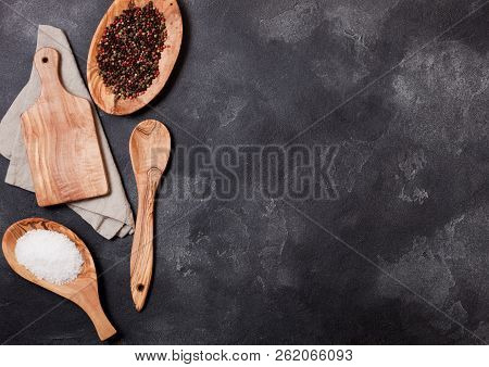 Olive Wood Kitchen Utensils With Chopping Board And Bowl On Stone Table Background. Top View.