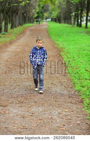 Im Looking Forward To The Future. Little Boy Enjoy A Brighter Future. Little Boy Walk Along Footpath