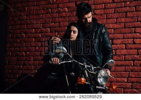 Hipster Couple. Hipster Couple Riding On Motorbike. Hipster Couple On Brick Wall Background. Road Tr
